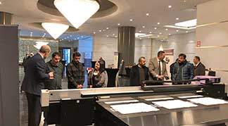 Mimaki Technology Promotion Tour people standing around printer